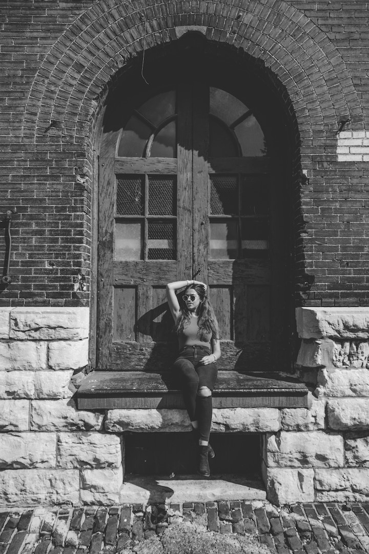 A model sitting in front of a old/ancient bulding